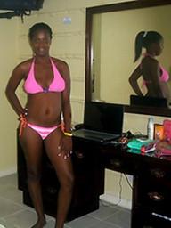 Young African girl in a pink bikini..