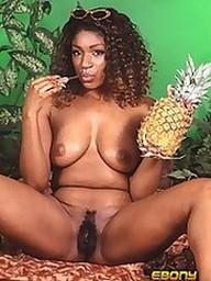 An ebony slut eating tropical fruit in..